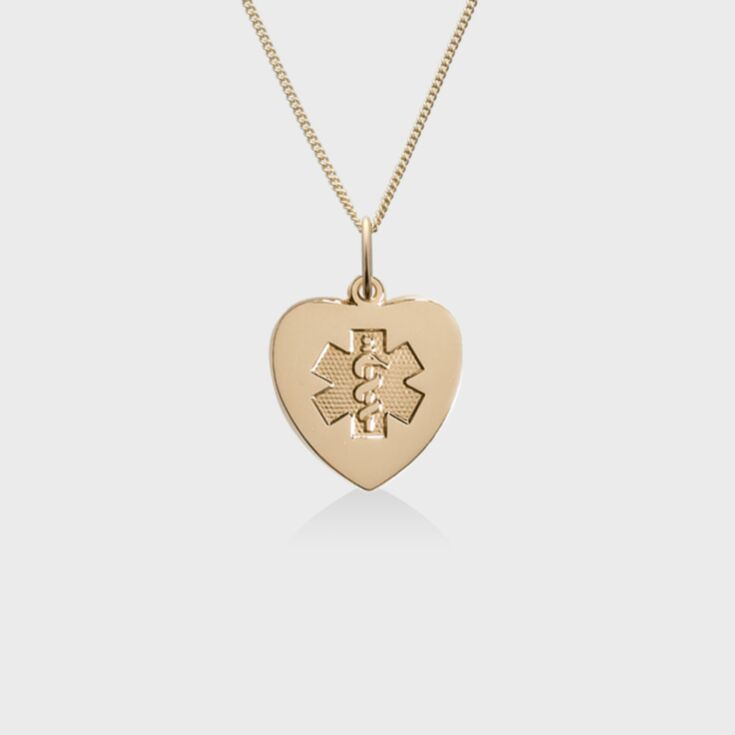 Heart-shaped gold pendant with embossed medical emblem