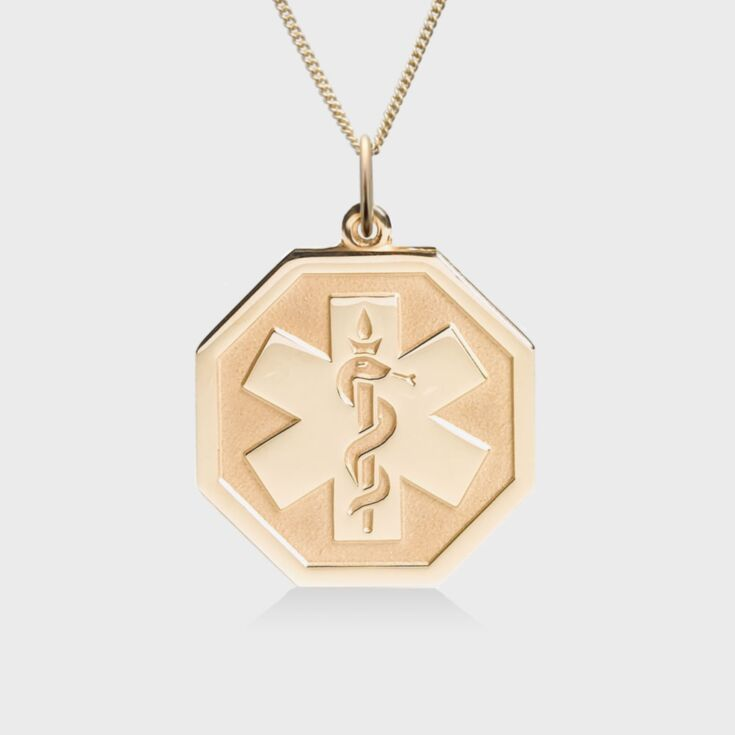 gold octagon shape medical id pendant, embossed with emblem